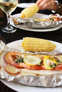 GRILLED NEW ENGLAND SEAFOOD BAKE  --  white fish, shrimp, potatoes, corn, butter, fresh dill, garlic, coarse salt and ground pepper, lemons