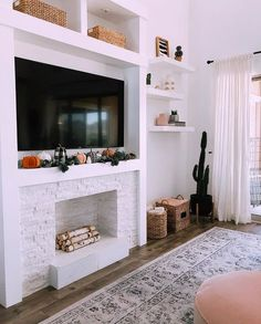 A faux fireplace proves you don't need to have a working chimney to get the cozy feeling of a fireplace. These ideas are all proof! Unused Fireplace, Basement Fireplace, Fake Fireplace, White Fireplace, Fireplace Inserts, Modern Fireplace, Living Room With Fireplace, Fireplace Ideas, Fireplace Decorations