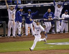 Kansas City Royals left fielder Alex Gordon celebrates a solo home run off New York Mets relief pitcher Jeurys Familia during the ninth inning of Game 1 of the World Series, Tuesday, Oct. 27, 2015, in Kansas City, Mo. (AP Photo/Charlie Riedel)