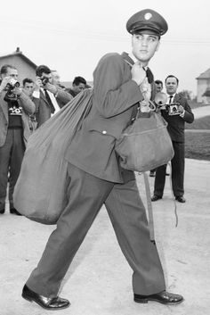 Photographed arriving with kit bag in Friedberg, Germany, October, 1958