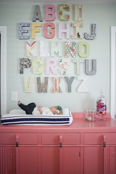 LOVE THIS FOR OLIVES ROOM Project Nursery - Coral Changing Table and Alphabet Gallery Wall - Project Nursery