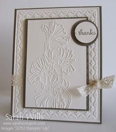 handcrafted thank you card ... white with black matting ... main panel has embossing folder flower bouquet ... background layer has the tulip frame embossing ... lovely!!