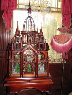 Similar to the Victorian bird cage that was first home of my love birds before they destroyed it - wood is not a good choice for love birds. This gorgeous wood birdcage looks fabulous just as it is! Nothing inside.