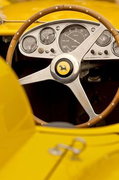 The cockpit of an early Ferrari. Nothing but business going on here but the spare nature of the design lends it extreme elegance. Ferrari has always cared, deeply, about every element of design; the streamlined nature of today's care comes from the company's birth as a racing-car manufacturer and racing team operator.