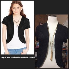 Short-Sleeve Sweater Shrug Keep Warm in the simplest way possible by layering this sweater shrug over fitted cami, tank or tee.     :Rayon  :Machine Washable :Collarless  :Open Front; no closure   : Short sleeves   : Allover open knit     : Hits at waist. American Rag Sweaters Shrugs & Ponchos