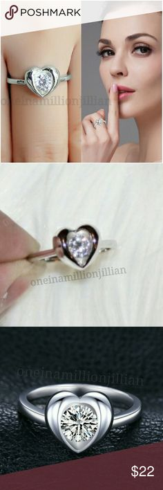 Sterling Silver CZ Open Heart Ring - Sz 7 New - Never Worn  Will come in a gift box  Size: 7  ☆ Authentic Solid Sterling Silver ☆ .6ct total gem weight ☆ Lab created cubic zirconia solitaire  Check my page for more great items & discounts. #oneinamillionjillian Jewelry Rings