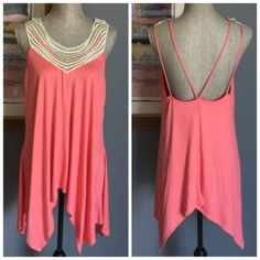 Crochet Neckline Trapeze Top Pretty coral color top from Nicole Polizzi .  Features a crochet neckline , soft flowing material , double shoulder straps .  Made of 95% rayon/5% spandex .  ✨Also available in my closet in size S✨ Nicole Polizzi Tops Tank Tops