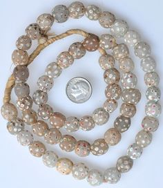 """Trade beads. Matched Venetian white """"Skunk"""" beads Length of strand: 24 inches, average size: 12mm Date: Mid to late 1800s - Price: $75.00"""