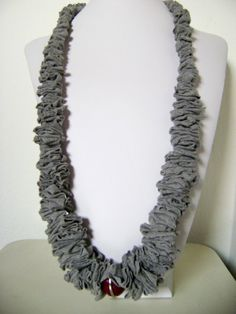Amy here's another craft u can do with all those shirts!, haha lmao  recycled t shirt necklace