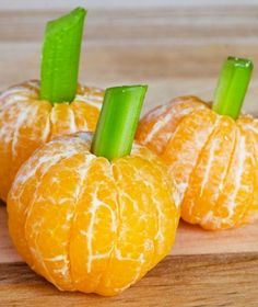 What an easy Halloween treat—just peel a few clementines and make stems out of celery sticks.