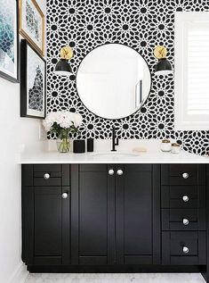 How to Go Bold in a Small Bathroom Gorgeous black and white bathroom with brass sconces, black cabinets, white carrara marble counter top, round mirror and graphic floral print tiled wall. Bad Inspiration, Bathroom Inspiration, Bathroom Ideas, Bad Wand, Estilo Interior, Farmhouse Side Table, Bathroom Wallpaper, White Wallpaper, Powder Room Wallpaper