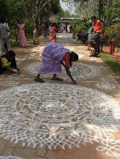 "Tenzin Kyizom Rangwang Beautiful ""Rangoli"". In India Rangoli is done at the front of Hindus home every morning and wiped away every evening by the women. They can be in white chalk or in color, depending on the families tradition. They can be simple or very elaborate."
