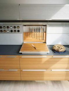 Inspiration. Oooh, integrated knife/cutting board. Love that it doesn't use up counter space when closed. Although, is there any way to alter it so that you can get the knives out without having to fully open it? I can see that being a pain...