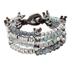 Bracelet with silver-plated beads, blue tone crystals and brown leather laces. Hand-crafted in Spain.