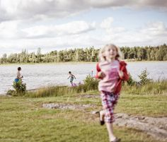 Kids playing near a lake. Sweden.  #kid #lifestyle #kids #playing #lake #sweden © Federico Leone