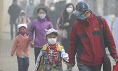 Young students and their parents wear masks to shield from air pollution