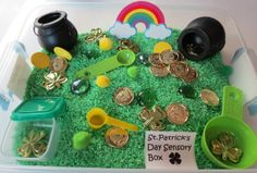 Sensory Bin Ideas: St Patrick's Day Included: 6 cups hand dyed rice 2 plastic kettles 1 laminated rainbow Plastic coins Plastic shamrocks 4 foam circles Assorted pom pom...