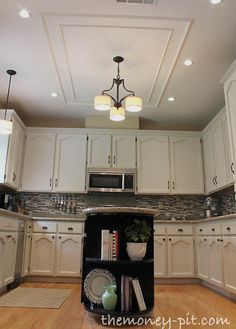 modernizing an 80 s oak kitchen, home decor, kitchen backsplash, kitchen cabinets, kitchen design, kitchen island, I added simple trim molding on the ceiling to not only mask where the old lighting fixture had been but also to add architectural detail to ceiling and define the space above the island