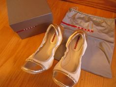 Available @ TrendTrunk.com White and Gold Prada Flats. By Prada. Only $175!