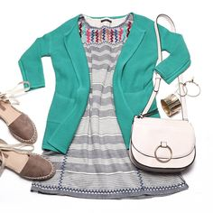 Colorful spring flatlay featuring a THML striped shift dress, teal green cardigan, and espadrilles great for the beach or a casual date!