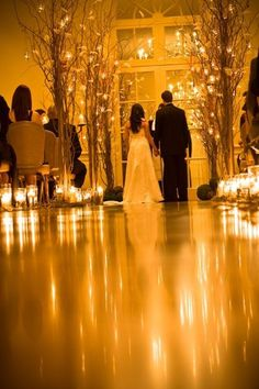 how to make these ambience? lots of candle ? weww :: Candlelit ceremony could work-- if it's an indoor winter wedding, it will get dark early enough to do the ceremony, then dinner