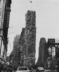 A Christo-wrapped building in Times Square, 1968 ~ !!! I didn't know they did this!