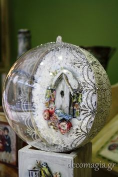 A unique ball with decoupage inside and special decoration on the back side