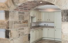 Stone arch in Featherdown, Cavil Head Farm, we love the thick stone walls and entrance to the luxury kitchen Stone Walls, Entrance, Arch, Luxury, Kitchen, Entryway, Longbow, Cooking, Paredes De Piedra