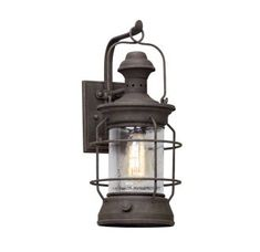 "View the Troy Lighting B5052 Atkins 1 Light 8"" Wide Hand Forged Outdoor Wall Sconce with Textured Glass Shade at Build.com."
