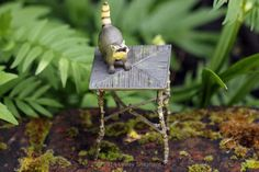 Custom Dollhouse Furniture  Instructions and Plans for Beginners: Make Dolls House and Fairy Furniture From Garden Twigs . This picture is a Rustic miniature table made from twigs in 1:12 dolls house scale.