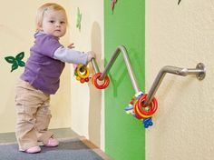 toys on a railing for babies wanting to pull up and stand #childcareideas