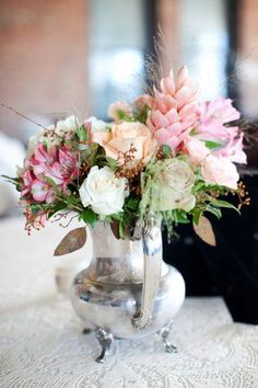 A silver flower pot adds vintage charm to this wedding centerpiece {Heather Smith Photography}