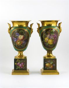 A large pair vases by Porcelain Painter Jacob Petit vases, each painted with two panels of fruit and flowers, the reverses with elaborate gilded designs, on a green ground, applied gilt mask handles, JP marks in underglaze blue, 1st half 19th century, some faults, 53.7cm. (2)