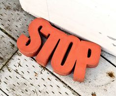 "Make a DIY concrete ""Stop"" to use as a door stopper. This tutorial shows how to use a styrofoam mold, clever."