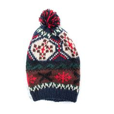 Christmas style multi-colored knit patterned pompom slouch beanie.