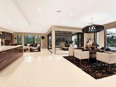 Open plan living room using black colours with laminate & bi-fold doors - Living Area photo 161698