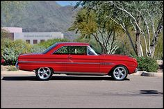 1963 Ford Falcon Sprint. My first car. I was 16. It cost 200 bucks and ran like it cost 175!  Robins egg blue.