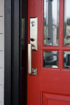 Curb appeal: 10 quick fixes for summer Red Front Door, Door Color, Front Porch Makeover, Dark Trim, Curb Appeal, Front Door Handles, Dark Grey Front Door, Grey Siding, Exterior House Colors