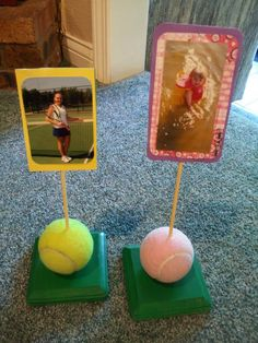 Tennis ball center pieces.  First painted square wood pieces from Michael's or Hobby Lobby, then screwed on a tennis ball from the bottom of the piece of wood.  Next drilled a small hole for a wood skewer, finally glued pictures to the wood skewers.