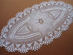 Handmade crochet doily color - white 100 % - cotton size - 23 inches x 11 inches ( 59 cm . x 29 cm . )