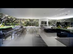 The home's elegant and open design was created with the intent of providing a sense of serenity and direct connection with nature.