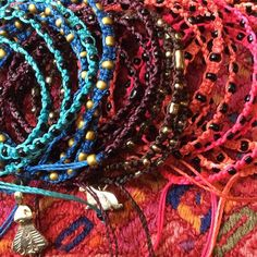 """Ketzali Bracelets-Make Your Color Bundle 3 for $42 """"Xubal""""- Handmade bracelets from Guatemala w/Black Metal Beads in Aubergine, Turquoise, Red, Hot Pink, Coral, ( Violet & Aquamarine Coming) & """"Wachinik""""- in Chocolate( Bunny) & Bright Blue( Goddess) w/Gold Metal Beads & Gold Metal Charm, all 26"""", Triple wrap, knotted w/beads on the ends, artisans signed on each tag,Ketzali donates potion of wholesale proceeds to promote fair trade in the region. Ketzali Jewelry Bracelets"""