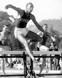 Jesse Owens Competing here over 220 yds low hurdles ( in which he set a world record ) no longer an official event