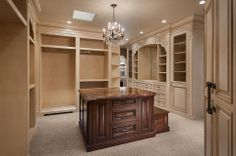 A closet made for a king and queen. For construction similar to this call Kevin Rose with RE/MAX Acadiana or visit http://www.MyLafayettehomes.com to search the MLS for similar construction in the Acadiana Area
