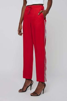Nail sports-cool in these striking red trackpants. Detailed with an elasticated waist, they feature a contrasting stripe to the leg. Team back with matching track top for a trending feel. #Topshop