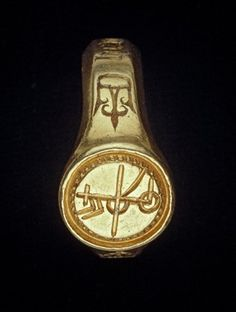 Gold signet-ring; engraved and enamelled; inscribed hoop with open crown on each shoulder; circular bezel with merchant's mark within toothed border.Europe, ca 15th century.