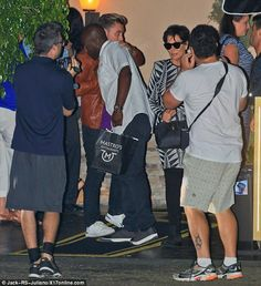 Bromance: Corey, who is in his thirties, was seen sharing a hug with Lance, 36, as they exited the venue