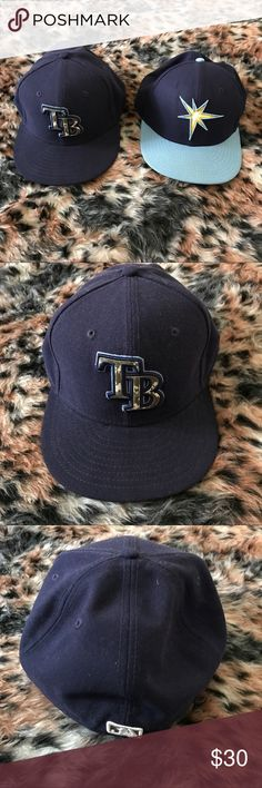 Tampa Bay Rays MLB Baseball Hat Cap Bundle A gently used baseball hat bundle that contains 2 items. They are a navy and camouflage Tampa Bay Rays cap by New Era in a size 7 1/2 and a navy and light blue Tampa Bay Rays hat by New Era in a size 7 1/2. (Both had adjustable bands.)  ✨ Ask me about free shipping! 💕 Always ships within 2 business day 🚫 I do not trade New Era Accessories Hats