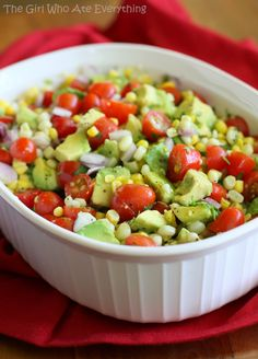 Corn, Avocado, and Tomato Salad 2 cups cooked corn, fresh or frozen (see Note) 1-2 avocados, cut into 1/2-inch cubes 1 pint cherry or grape tomatoes, halved 1/2 cup finely diced red onion Dressing: 2 tablespoons olive oil 1/2 teaspoon grated lime zest 1 tablespoon fresh lime juice 1/4 cup chopped cilantro 1/4 teaspoon salt 1/4 teaspoon pepper