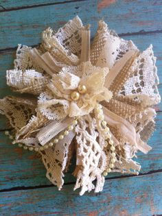 Visit me at dolledanddazzled.etsy.com  Handmade burlap flower embellished with vintage lace and doily. Great to attach to a lampshade or use as a curtain tieback.